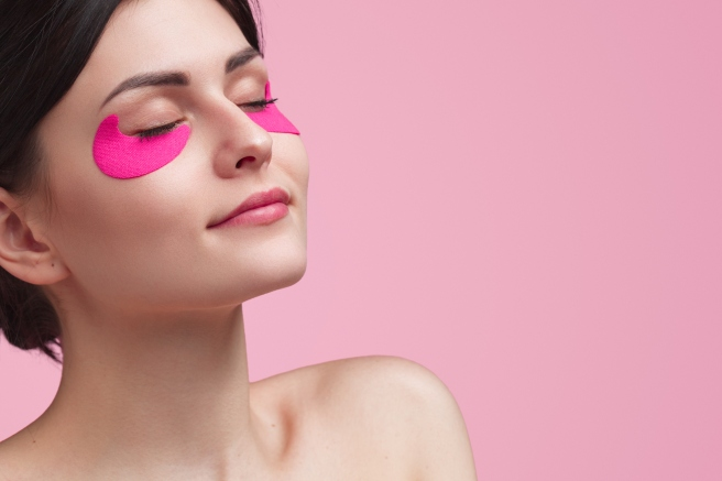 Attractive young woman having under eye mask