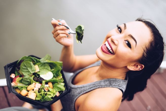 healthy woman eating the salad